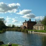 Hire narrowboat going through Kibworth on the Grand Union canal Leicester section